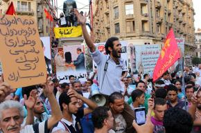 Protesters rally against Morsi's IMF deals and the detention of political prisoners