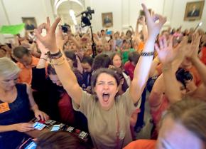 Protesters pack the Texas Capitol building to obstruct a vote on an anti-abortion bill