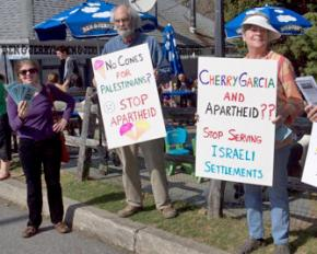 Palestine solidarity activists protest Ben & Jerry's during a free cone giveaway day