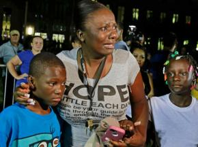 A woman responds to the verdict in the Zimmerman trial