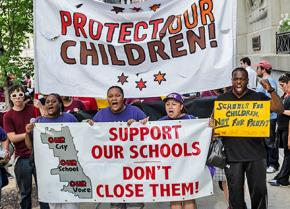 Students and parents on the march against school closures in Chicago