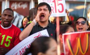Low-wage workers and their supporters rally outside a McDonalds