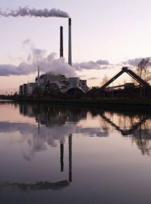 A coal-fired power plant billows smoke