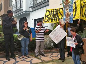 Dozens of supporters gathered to help Alcides Perla re-occupy his home