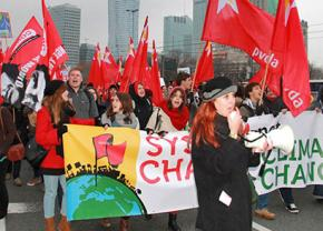 Protesters march for system change outside the Warsaw climate conference