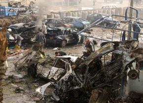 Wreckage left behind after a car bombing in Baghdad