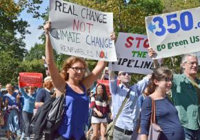 Anti-fracking activists march against the newly opened Spectra pipeline