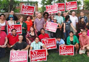 Ty Moore (center with pink shirt) surrouned by supporters of his socialist campaign for City Council in Minneapolis