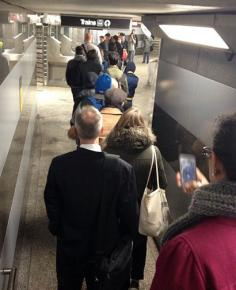 Ventra delays create a long line of commuters at a Chicago transit station