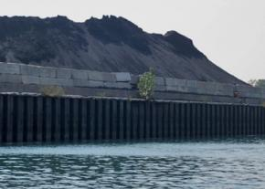 Petcoke stored on the banks of the Calumet River south of Chicago