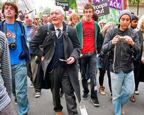Tony Benn (second from left) marching against war in London