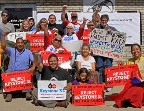 Members of the Cowboy Indian Alliance join with other climate justice activists at a Nebraska protest