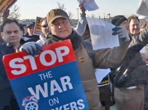 Members and supporters of Teamsters Local 804 rally in defense of 250 fired workers