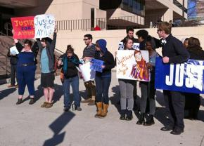 Suuprters outside the court house call for justice for Ayyub