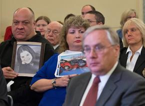 Families of car crash victims sit behind GM executives at a Congressional hearing on the recall delay