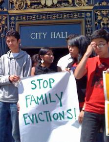 Anti-eviction protesters gather on the steps of San Francisco's City Hall