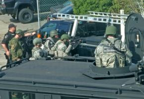 Gabe Camacho took this photo of militarized police besieging the house across from him