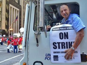A postal worker shows his sympathy with the Chicago teachers strike