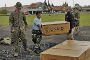 Workers in Indonesia unload relief supplies from USAID following a 2009 earthquake