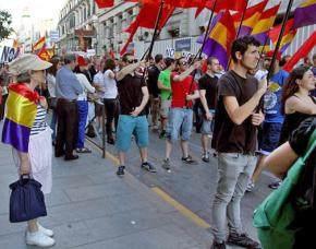 Supporters of Podemos join in a rally against the Spanish monarchy