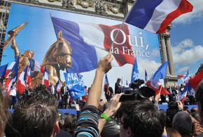 Supporters of the National Front rally during a speech by Marine Le Pen