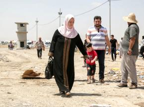 People fleeing the fighting in Mosul arrive at a checkpoint near Erbil
