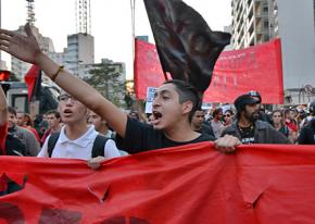 Protesters march in São Paulo to defend fired transit workers and the right to demonstrate during the World Cup