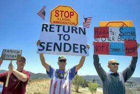 Anti-immigrant bigots protest detainees in Murrieta, Calif.