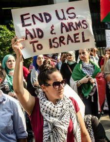 Protesters rally against the ongoing Israeli assault on Gaza