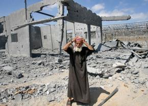 A Palestinian man reacts to the demolition of his home in Gaza
