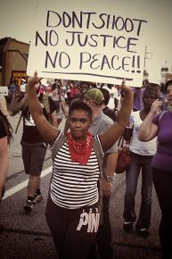 Marching along West Florissant in Ferguson, Mo.