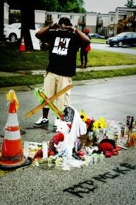 A man pay his respects at the shrine to Mike Brown