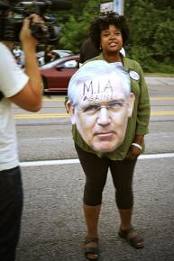 Missouri State Sen. Maria Chapelle-Nadal with a giant cutout head of Democratic Gov. Jay Nixon