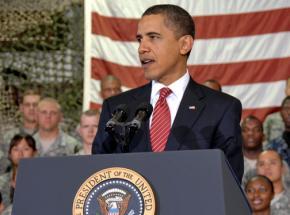 Barack Obama speaking in front of U.S. troops