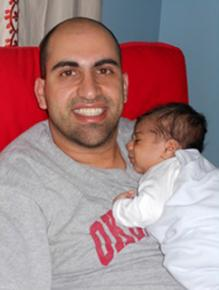 Steven Salaita poses with his child