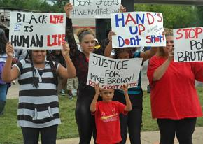 Lining the streets of Ferguson, Mo., to protest police murder
