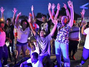 A vigil in Ferguson, Mo., for the victim of police murder