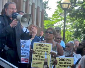 Supporters surround union activist Steve Kirshbaum at a solidarity protest