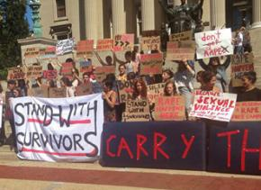 Columbia University students stand with survivors of sexual assault