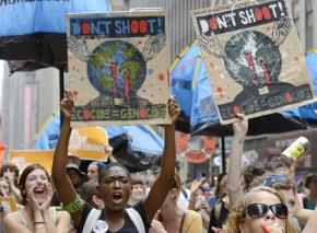 Marchers in the massive climate justice demonstration in New York City