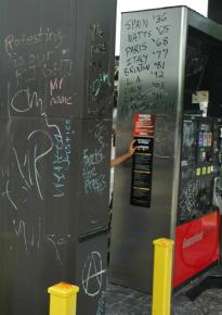 Grafitti at the QuikTrip in the center of Ferguson, Mo.