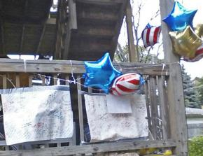 A memorial for Roshad McIntosh on the back deck of the building near where he was shot