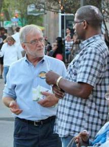 Howie Hawkins talks to a voter in Rochester, N.Y.