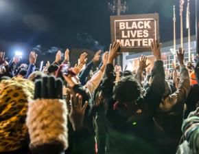 Protesters outside the Ferguson Police Department headquarters