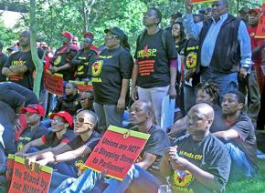 Members of NUMSA demonstrate outside COSATU headquarters