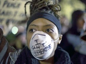 Protester against the non-indictment of NYPD officer Daniel Pantaleo for the murder of Eric Garner