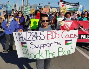 UAW Local 2865 member supporting BDS at the Block the Boat action in the Bay Area