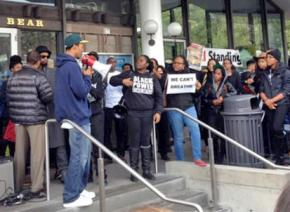 Members of the Black Student Union at UC Berkeley blockade a campus dining facility