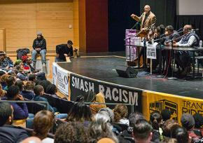 Hundreds came to a forum on #BlackLivesMatter in Seattle to hear speakers like John Carlos (at microphone)