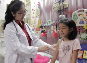 A doctor administers a vaccine